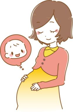 座っている妊婦さんがお腹をさすっている写真